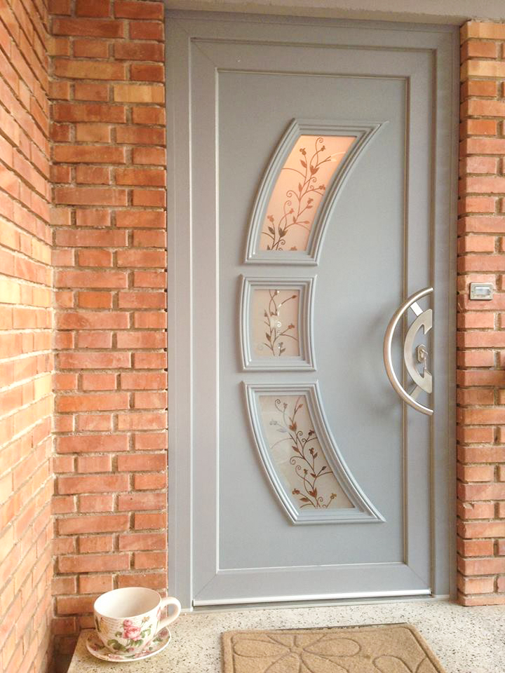 Door with panel with decorative glass
